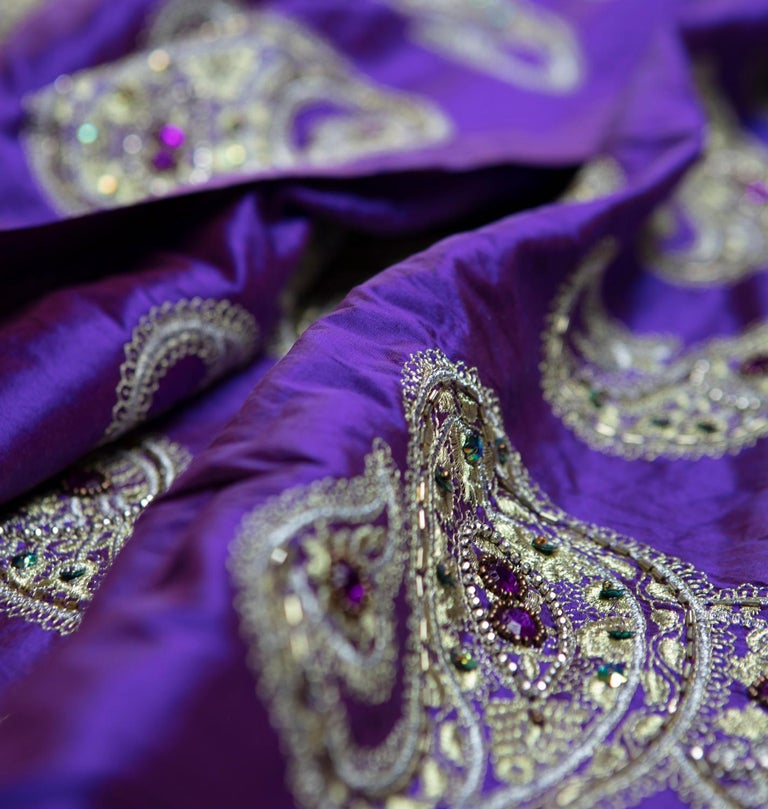 Vintage, theatrically created for celebrities in a violet iridescent raw silk fabric with highly embellished dramatic paisley design of hand-hooked metallic embroidered gold and silver in a Classic Ari handwork with amber, amethyst and emerald