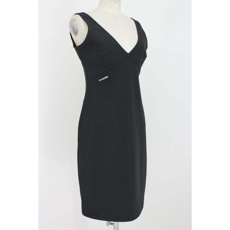 Vintage woman dress Versace Jeans Couture. Elegant black sheath dress, 92% polyester 8% elastene. V-neckline, side zip. 90s. Made in Italy. Excellent vintage condition.  Size: 46 It 12 Us 14 Uk  Shoulder: 46 cm Bust/Chest: 48 cm Length: 79 cm