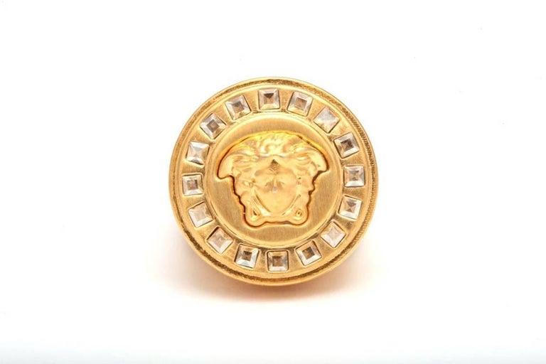 Versace iconic Medusa motif ring with rhinestones, size 7. Unisex.