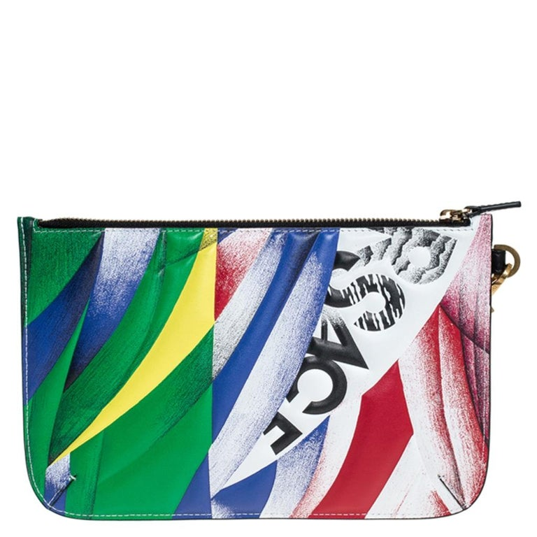Store your essentials effortlessly in this sturdy leather clutch. It features a multicolored clash print all over the exterior and a zipped compartment. Featuring a wristlet, this superb pouch is a stylish accessory.  Includes: Original Dustbag,
