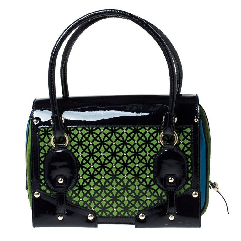 Include some magic to your everyday look with this excellent suede and patent leather handbag. The satin interior of the bag is spacious and the two handles offer an easy grip. To make a remarkable style statement, this bag by Versace is just what