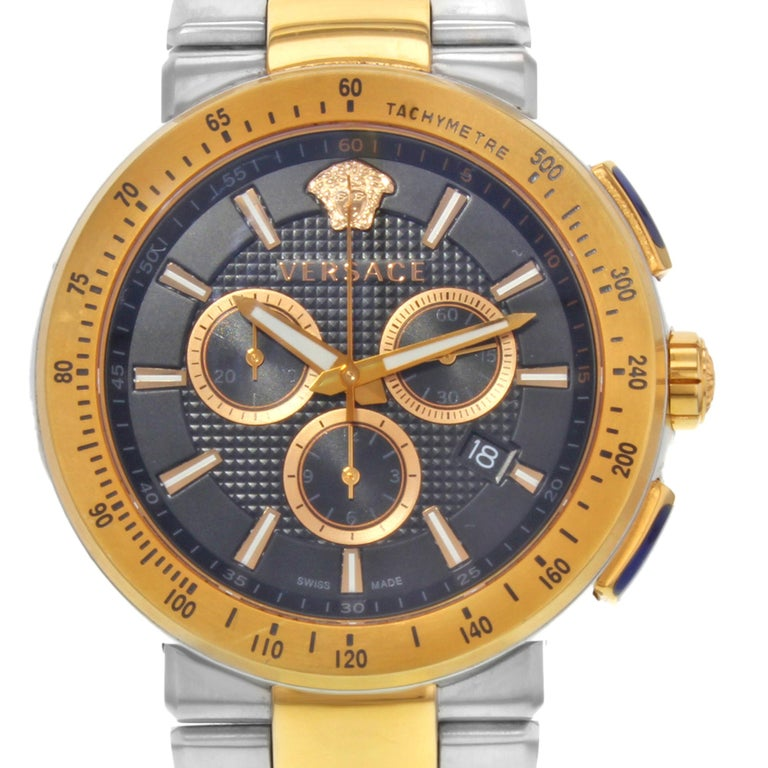 This pre-owned Versace Mystique  VFG100014  is a beautiful men's timepiece that is powered by a quartz movement which is cased in a stainless steel case. It has a round shape face, chronograph, date, small seconds subdial, tachymeter dial and has
