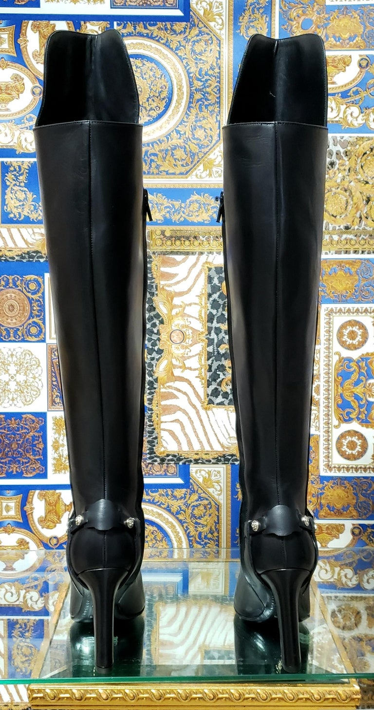 VERSACE    These over the knee leather boots are finished with high heel and Silver-tone Medusa hardware  Color: Black   Content Upper:  100% leather with metal stud accents .   Sole: 100% leather     Size 5 - US 5   Made in Italy  Brand new. Comes