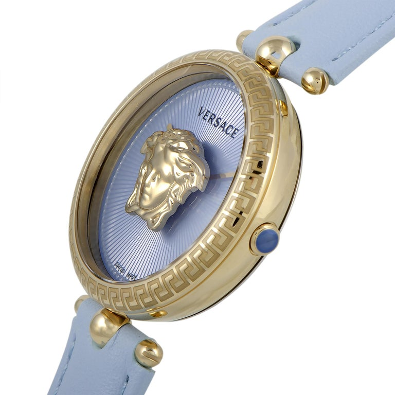 The Versace Palazzo Empire watch, reference number VECQ00918, comes with a 34 mm stainless steel case that offers water resistance of 50 meters. The case is presented on a light blue leather strap fitted with a deployment clasp. The watch is powered