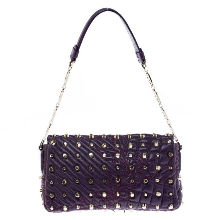 This Vanitas Medea purple bag is an absolute delight. The Versace creation features a quilted effect along with gold-tone studs and the medusa tassel logo on the front. Crafted from leather the bag features a top handle and a fabric lined