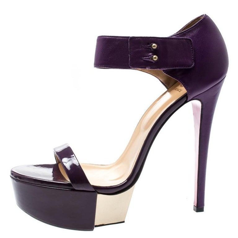 These Versace sandals are just what you need to take your style a few notches higher. These beauties are crafted from leather and styled with a patent leather strap on the front, ankle straps and 14.5 cm heels supported by platforms. Add these