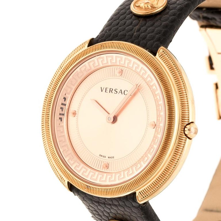 Simplicity and elegance find their way into a perfect combination with style and glamour to complete this stunning watch by Versace. Crafted out of rose gold-plated stainless steel and held by leather, this quartz watch features dot hour markers,