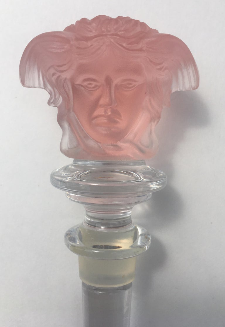 """Etched carved pale rose/pink crystal wine decanter stopper by Versace for Rosenthal. Iconic Versace Medusa head on both sides of stopper. Original black and gold Greek key motif box. This beautiful bar accessory is marked """"Rosenthal"""" """"Versace"""". Made"""