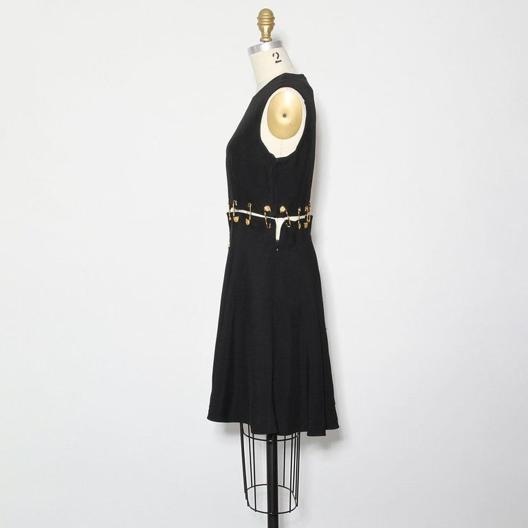 From the Iconic Spring Collection of 1994, this lifetime Gianni Versace safety pin mini dress is a prime example of the designer's house elements and the spirit of the early-mid 1990s. The sexy proportions of the minimal silhouette and shorter