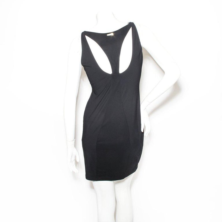 Swim dress by Versace Black  Sleeveless  Slip-on  Cut out neck  V-neck detail  Medusa clasp (can be unclasped but not fully removed)  Made in Italy  Condition: Excellent, little to no visible wear. (see photos)  Size/Measurements: (approximate,