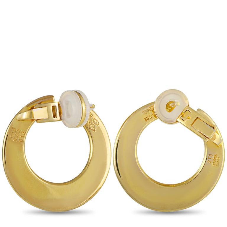 """These vintage Versace earrings are made out of 18K yellow gold and enamel and each weighs 6.8 grams, measuring 1"""" by 1"""". The earrings include the manufacturer's box."""