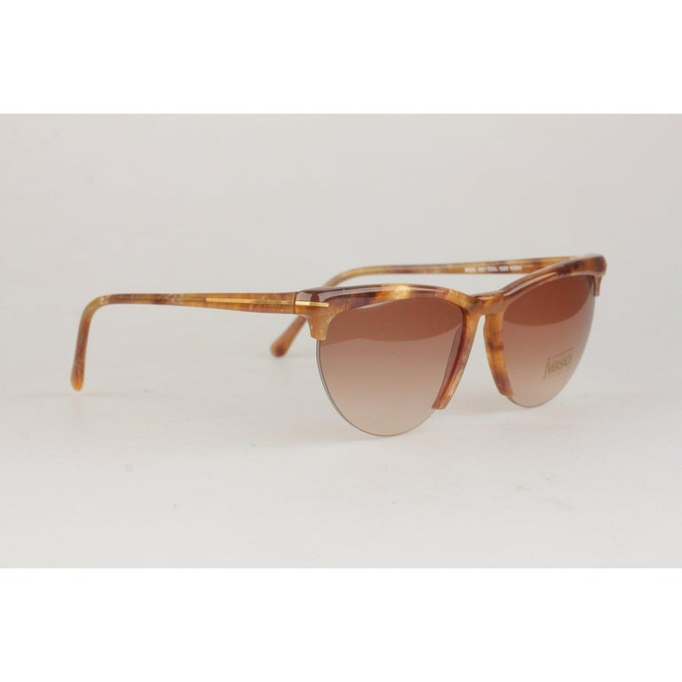 MATERIAL: Acetate COLOR: Brown MODEL: Mod. 391 Col 928 GENDER: Adult Unisex SIZE: Medium COUNTRY OF MANUFACTURE: Italy Condition CONDITION DETAILS: NOS (NEW OLD STOCK) Never worn or Used- They will come with a Generic Case Measurements MEASUREMENTS: