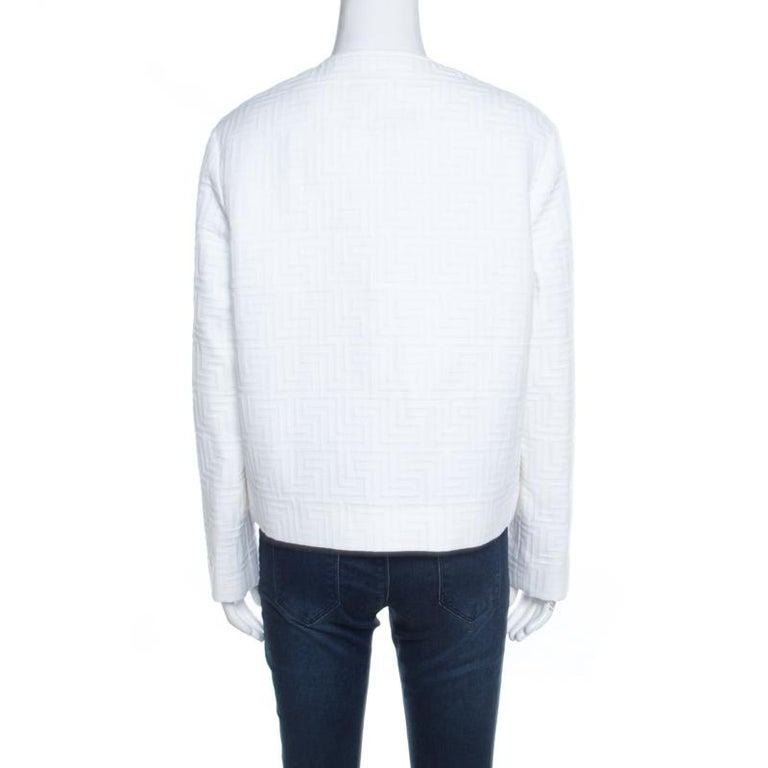 A classic jacket carrying a white hue is a piece that every modern-day fashionista must have. Coming from the house of Versace, this jacket is every bit elegant and classy. The signature embossing the expanse and frontal zip fastening make this