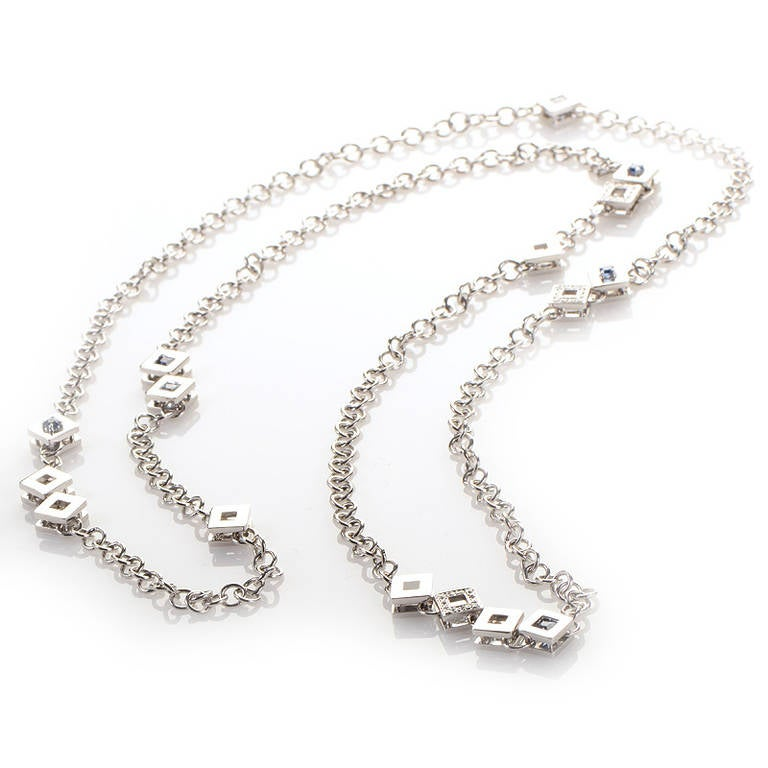 This gorgeous necklace from Versace is unique and opulent. It is made of 18K white gold and features a design with multiple stones dispersed throughout and diamonds. Retail Price: $32,500.00 (Plus Tax)