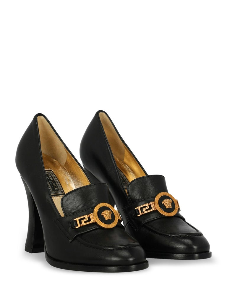 Loafers, leather, solid color, embossed logo, gold-tone hardware, round toe, leather insole, block heel, high heel, leather lining, metal application. Product Condition: Like New With Tag.