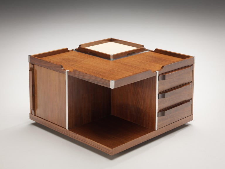 Side table, walnut, metal, Italy, 1970s  This Italian side table combines function with lovely Italian aesthetics of the 1970s. The squared coffee table on wheels presents multiple features. First the dry bar that reveals itself if you pull up the