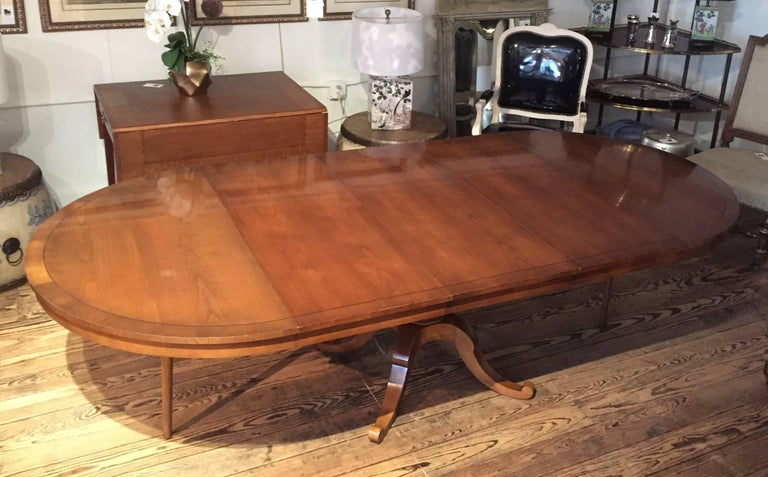 versatile round and expandable vey long oval cherry dining