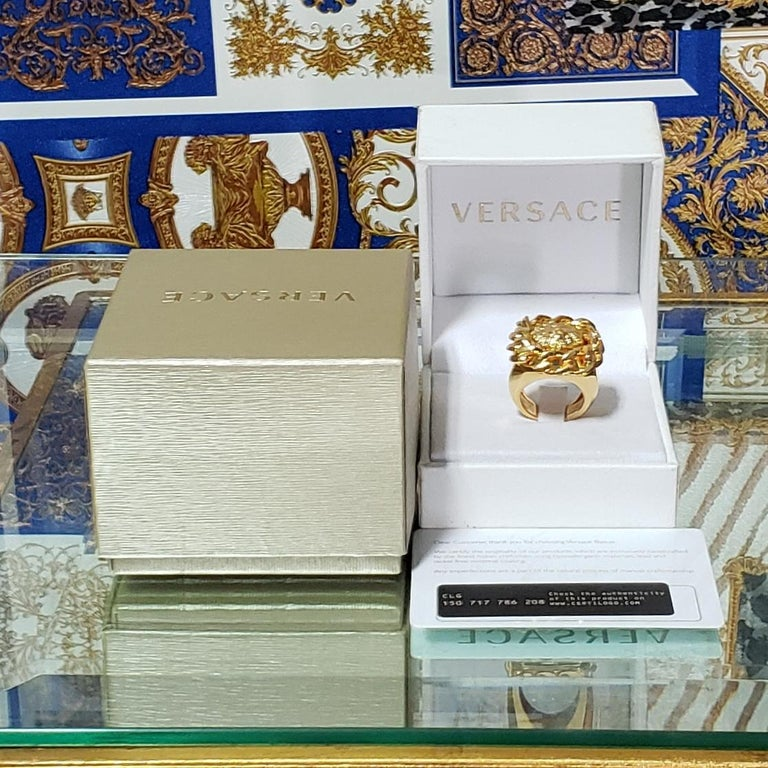 VERSACE   24K Gold Plated Lion Fashion Ring      Made in Italy    Brand new. Display model, got minor scratches. 100% authentic guarantee. Comes with Versace box.         PLEASE VISIT OUR STORE FOR MORE GREAT ITEMS