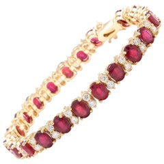 Very Beautiful 29.80 Carat Ruby and Natural Diamond 14 Karat Solid Gold Bracelet
