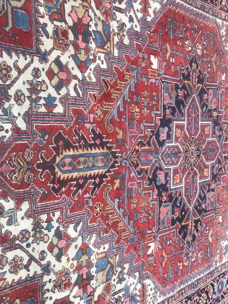 Nice early 20th century large rug with beautiful decorative design with a central medallion and natural colors with red, blue, yellow, dark blue and green, entirely hand knotted with wool velvet on cotton foundation.