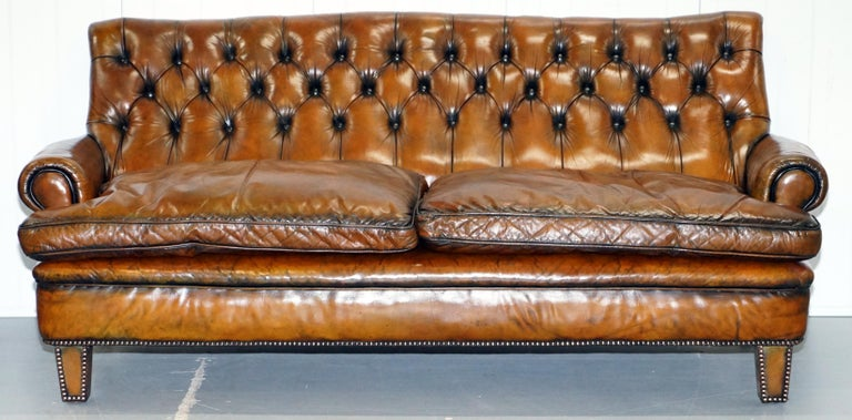 We are delighted to offer for sale this stunning very comfortable and rare fully restored cigar brown leather Howard & Son's style Victorian sofa  One of the most comfortable sofas we've ever had comes through the warehouse, the seating angle is