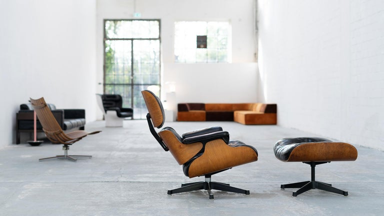 Very early Charles & Ray Eames lounge chair with ottoman from European version contura, 1957-1965. The lounge chair is in very good condition and absolutely collectible.  An absolutely rare collector's edition in original condition. We have