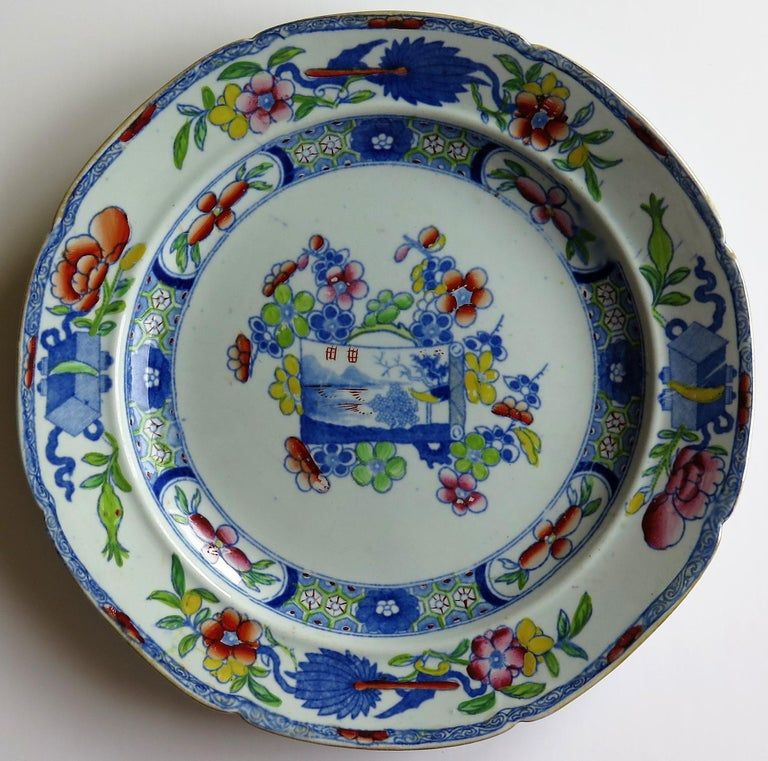 This is an ironstone pottery deep plate or bowl produced by the Mason's factory at Lane Delph, Staffordshire, England during their initial period of Ironstone production, circa 1815.