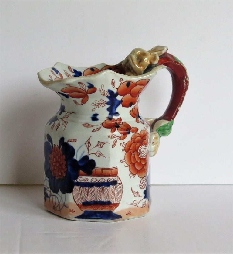 This is a very early, decorative Mason's Ironstone Jug or pitcher, made at their Lane Delph factory, Staffordshire Potteries, England, in the early 19th century, George 111rd period, circa 1815.  This jug has the