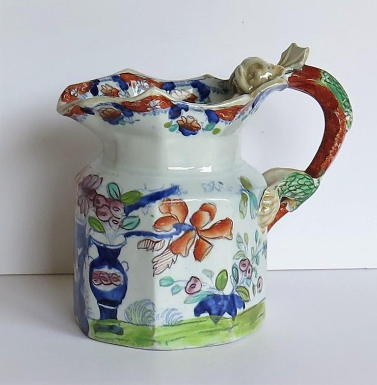 This is a fine and rare, large ironstone pottery jug or pitcher in the Fenton shape made by Mason's Ironstone, of Lane Delph, Staffordshire, England, circa 1815.  The jug is octagonal in section and potted in the rarer Fenton shape with an