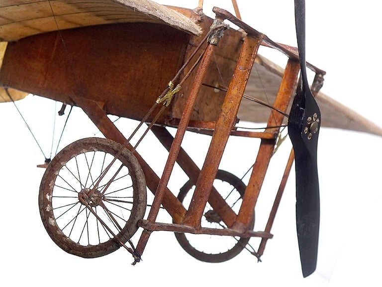 In 1909 French aviation pioneer Louis Bleriot completed the first successful crossing of the English Channel by air. The hand built model is very old and quite fragile I'm amazed it lasted this long. I am guessing this was built just after Bleriot's