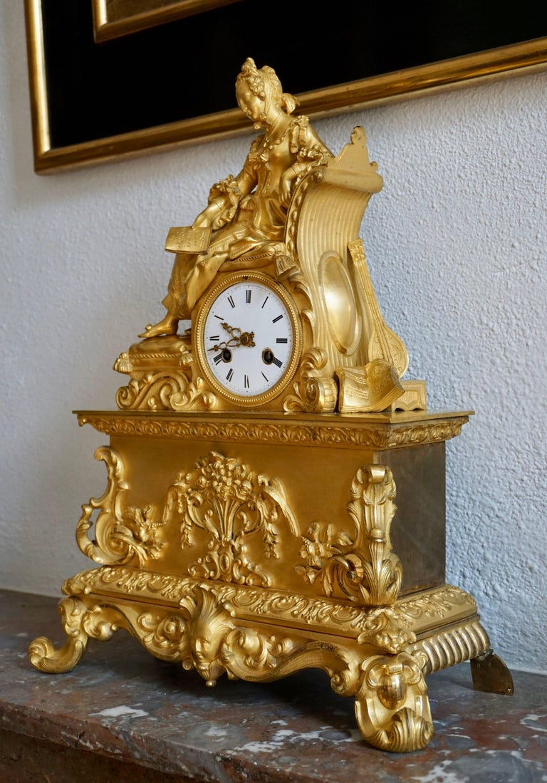 French Very Fine and Elegant Fire, Gilt Bronze Mantle Clock in the Romantic Taste For Sale