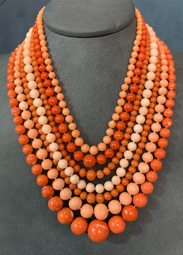 Very Important Seven Strand Coral Bead Necklace A magnificent collection featuring every shade of coral: Ox blood, angels skin, pink, white.  With 18K Yellow Gold clasp. 238  grams gross weight Measurements: 20
