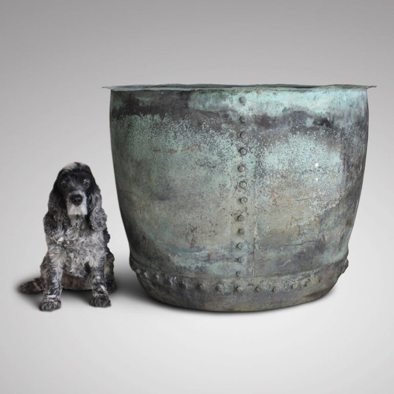 A very large, early 19th century riveted copper boiler, for use as a garden planter or log bin. In excellent condition, with the most beautiful and natural verdigris patination. No structural damage or repairs, with two drainage holes in the base,