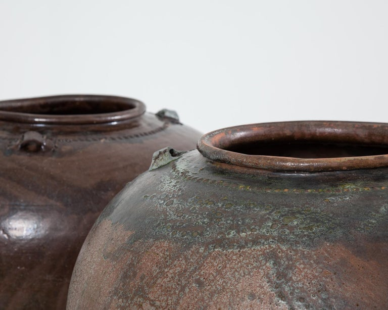 Very large, spectacular looking 20th century Spanish pots.  Both pots are in good sound condition, the smaller pot has a stabile crack which likely happened during the firing process.  The pots are available to purchase individually or as a