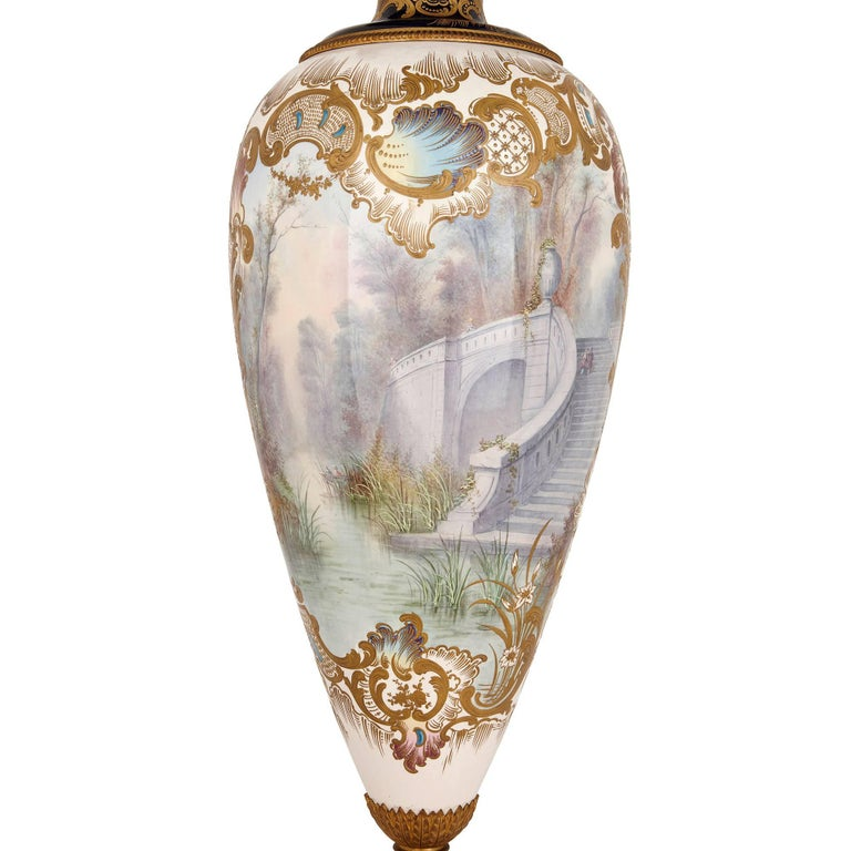 This fantastic vase is the work of J. Pascault, a famed porcelain artist of the late 19th century who specialised in the production of Sevres-style pieces. It is beautifully executed, and especially impressive given its large size of one and a half