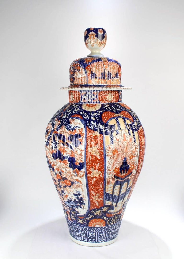 An extraordinarily large, antique Japanese Imari covered urn or floor vase.
