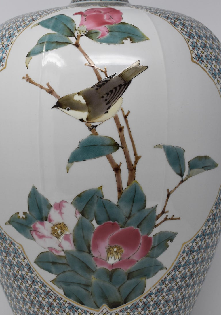Outstanding contemporary very large Japanese Kutani porcelain decorative vase, extremely intricately hand painted on a stunning baluster shape body, a signed masterpiece by highly celebrated and award-winning Kutani master porcelain artist. This