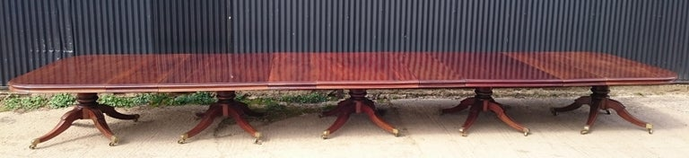 Very large and important Regency mahogany five pedestal antique dining table. This dining table is an impressive scale, standing on five pedestals each with four splay legs. The edge has double thickness molding all the way around, including on the
