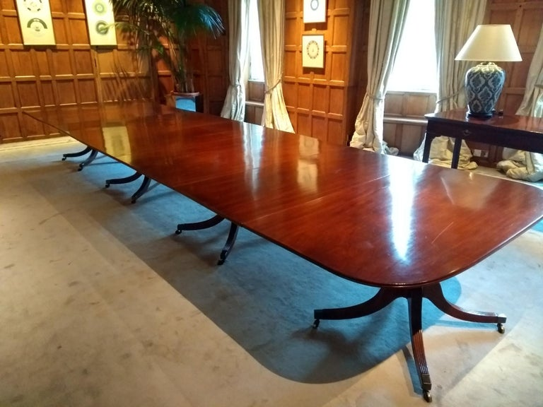 18th century George III period mahogany four pedestal antique dining table. This is one of the best tables we have seen, it is a tremendous scale at almost eighteen feet long and very well drawn. It has elegant outstretched four splay legs which are