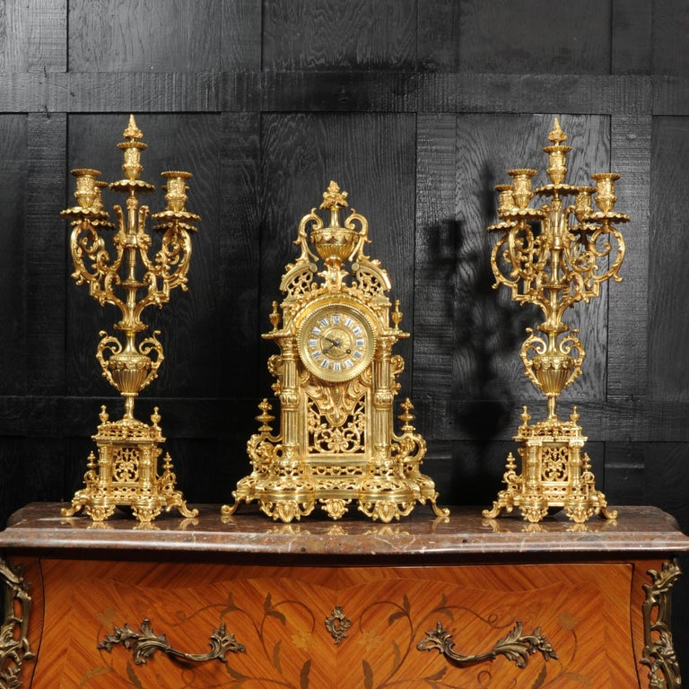 A huge original antique French Baroque clock set dating from circa 1880. Beautifully and substantially modelled, and finished with a lovely original gild. It is of architectural form with a swans neck pediment surmounted by an urn with an final of
