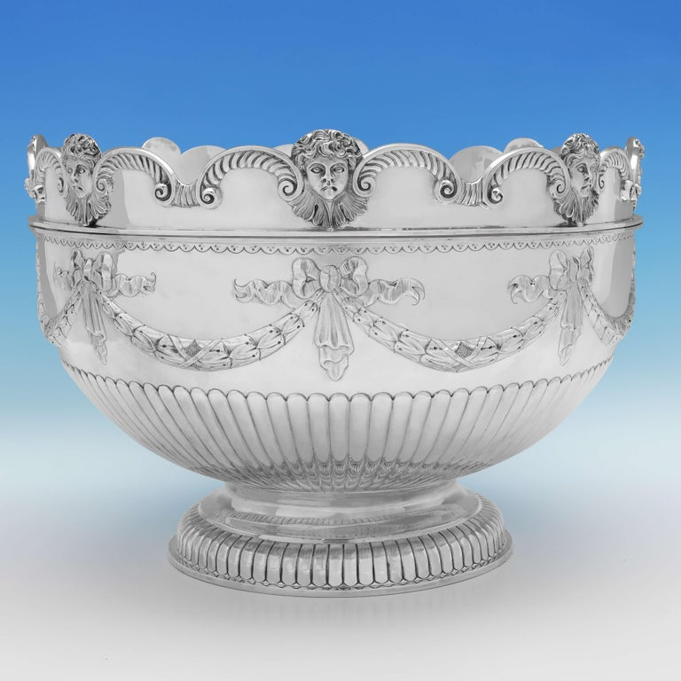 Hallmarked in London in 1880 by Aldwinckle & Slater, this attractive, very large, Victorian, antique sterling silver bowl, is in the 'Monteith' style, featuring a removable rim, and a gilt interior to the bowl. The bowl measures 11.25