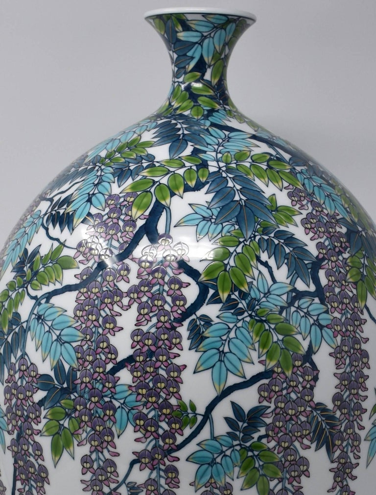 Extraordinary very large contemporary Japanese decorative porcelain vase, extremely intricately hand painted in vivid blue, turquoise and purple on a gracefully shaped very large baluster body, a signed masterpiece by highly celebrated,