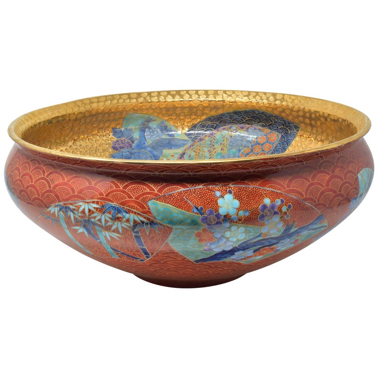 Highly collectible very large contemporary porcelain decorative bowl/centerpiece, an exhibition piece in red and dimpled gold, an outstanding masterpiece by widely respected award-winning Japanese master porcelain artist in the Imari-Arita style. In