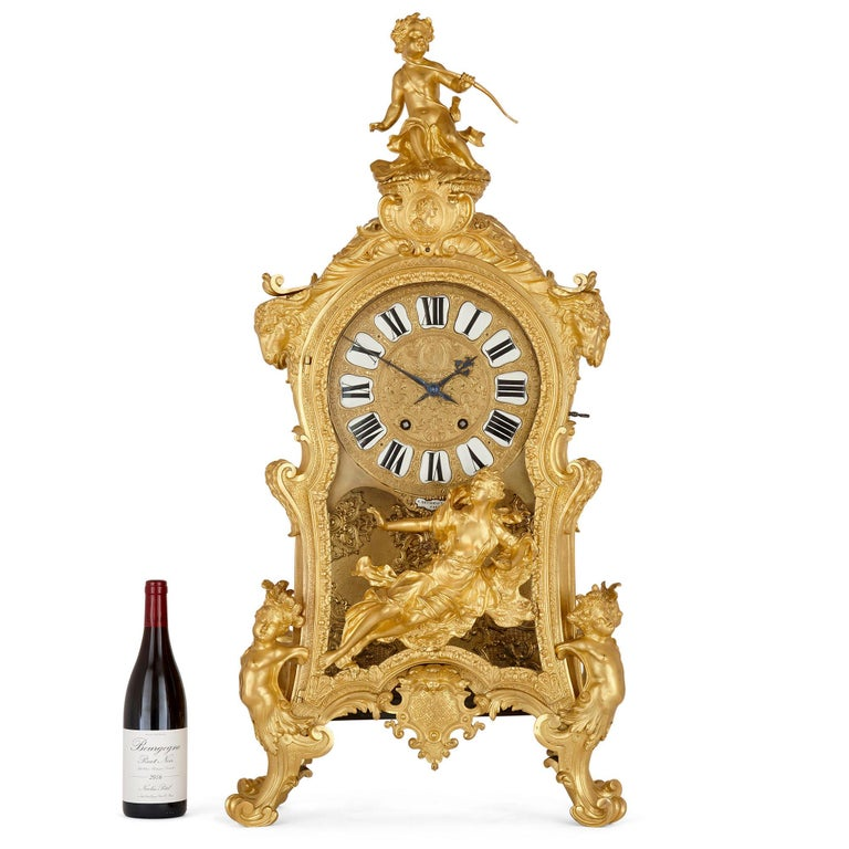 Very large Louis XV style gilt bronze mantel clock by Beurdeley French, circa 1880 Measures: Height 102cm, width 48cm, depth 29cm  This very large mantel clock is a magnificent example of 19th century French decorative art by one of its very