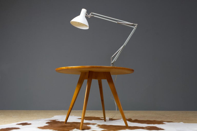 """Very large Dutch industrial """"Angelpoise"""" desk light made by Hala Zeist (Holland) in white, 1960s (collection 1967). The table lamp is set on a heavy black lacquered metal base with a long articulating arm and white metal cap. When the lamp is fully"""