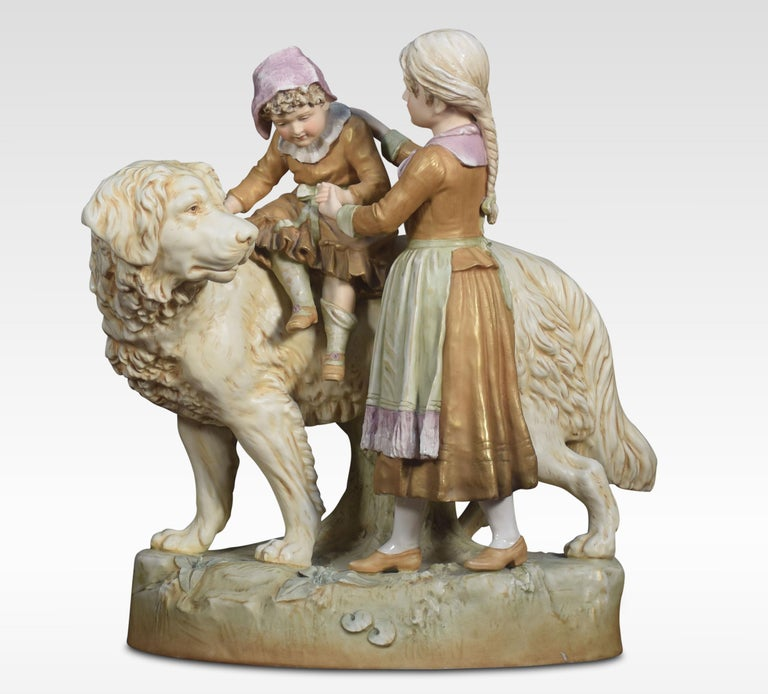 Very large Royal Dux porcelain figure group, of a dog, mother, and child realistically modelled and coloured in ivory and soft shades of green and pink on an oval earthy ground. Impressed and printed marks and numbers underside together with the