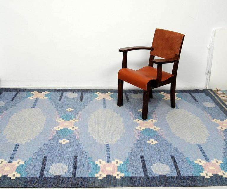 A large flat-weave rölakan carpet named