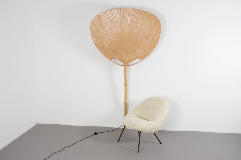Rare large 'Uchiwa' fan floor lamp by Ingo Maurer in very good condition.  Designed by Ingo Maurer for M design, Germany.  This lamp was handmade in 1977 from bamboo, wicker and Japanese rice paper. They are very fragile and therefor very hard