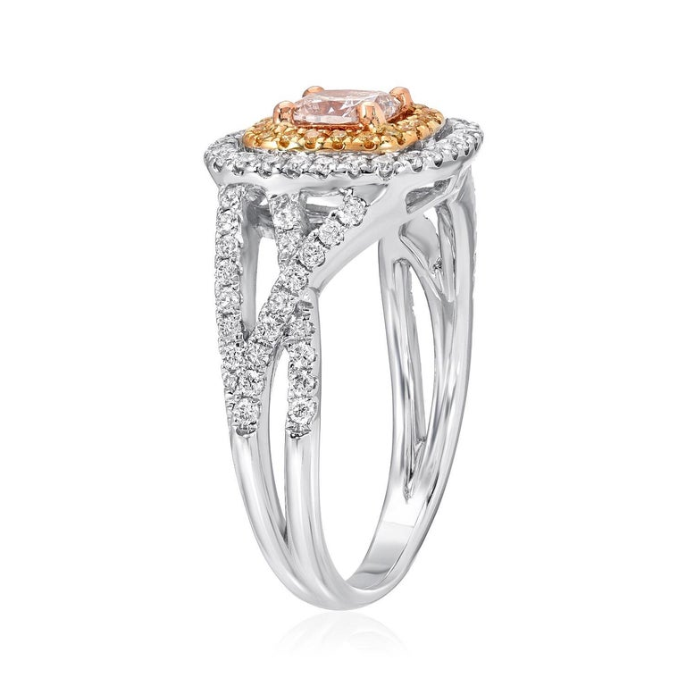 GIA certified 0.45 carat very light Pinkish Brown cushion cut diamond, surrounded by a round brilliant yellow diamond halo weighing a total of 0.09 carats, and adorned by a total of 0.46 carats of white round brilliant diamonds, all comprising this