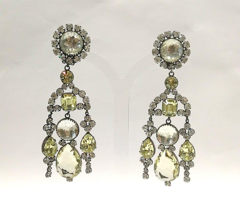 These truly stunning earrings from the early creations of Kenneth Jay Lane in the 1960s, detail an unusual and sophisticated colour combination of clear and pale citrine pastes of varying cuts and sizes, set in an antiqued silvered metal.